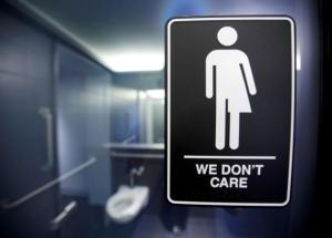 A sign protesting a recent North Carolina law restricting transgender bathroom access adorns the bathroom stalls at the 21C Museum Hotel in Durham, North Carolina May 3, 2016. REUTERS/Jonathan Drake